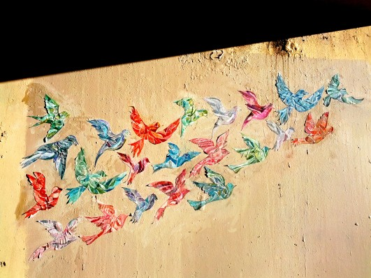 Small mural paste-up, a touch of colour in a drab underpass